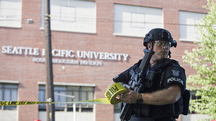 A policeman secured the scene after a shooting at Seattle Pacific University on June 5, 2014 that left one student dead. There has been a string of mass shootings in the US in recent weeks, as well as one in New Brunswick, Canada.
