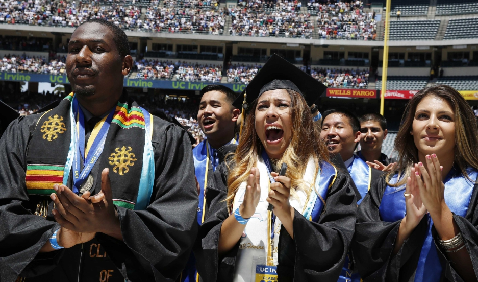 Students cheer as US President Barack Obama (not pictured) attends the 2014 commencement ceremony for the University of California, Irvine, while at Angels Stadium in Anaheim, California.