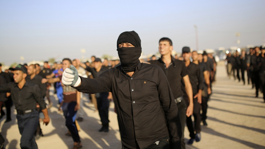 Mehdi Army fighters loyal to Shiite cleric Moqtada al-Sadr march during a military-style training in the holy city of Najaf, June 16, 2014.