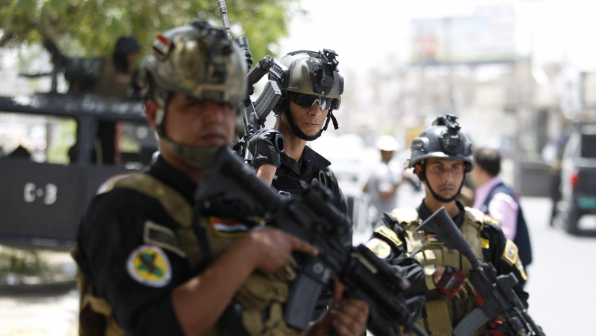Members of the Iraqi Special Operations Forces take part in an intensive security deployment in Baghdad's Amiriya district, June 18, 2014.