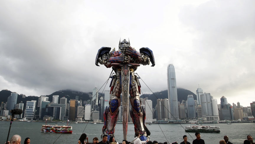 "A 21-foot tall model of the Transformers character Optimus Prime is displayed on the red carpet before the world premiere of the film ""Transformers: Age of Extinction"" in Hong Kong."