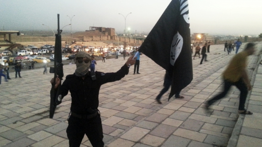 A fighter of the Islamic State of Iraq and Syria - ISIS -  on a street in the city of Mosul.