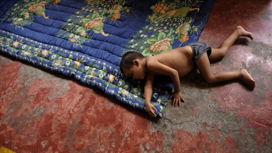 A Honduran child sleeps at an immigrant shelter in Chiapas, in southern Mexico.  His is traveling with his family from his impoverished and violent neighborhood to northern Mexico or the US.