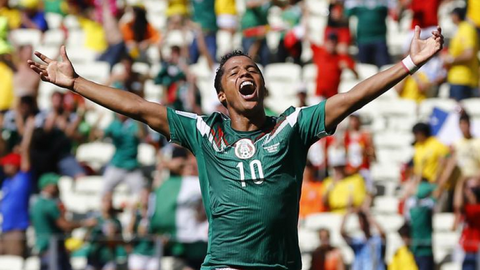 Giovani Dos Santos celebrates after scoring a goal for Mexico at the 2014 World Cup