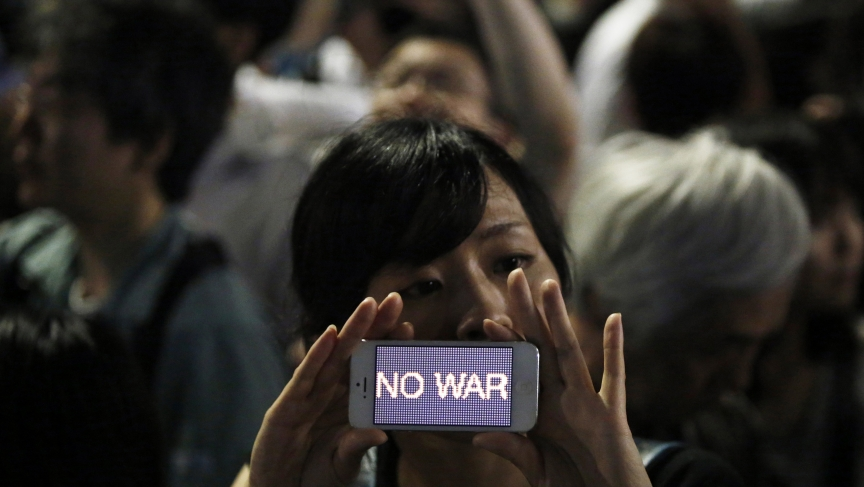 A protester at a rally against Japan's Prime Minister Shinzo Abe's push to expand Japan's military role.