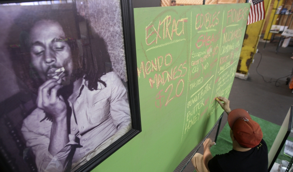 A portrait of Bob Marley hangs in a market in Los Angeles
