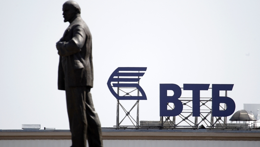 Russian-owned VTB Bank will be impacted by EU sanctions against Russia's economy. A monument of Soviet state founder Vladimir Lenin stands on the top of a building.