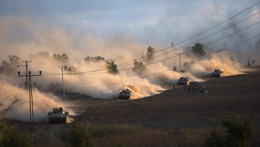 "Israeli tanks maneuver outside the northern Gaza Strip on July 18, 2014. Israel intensified its land offensive in Gaza with artillery, tanks and gunboats on Friday and warned it could ""significantly widen"" an operation Palestinian officials said was killi"