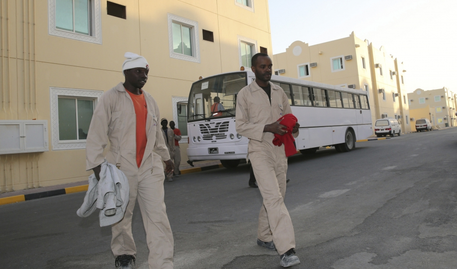 Laborers working on the Qatar 2022 World Cup project arrive at their accommodations in Doha.
