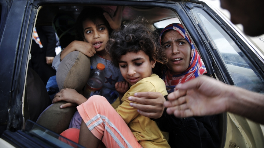 Palestinians fled in a vehicle Monday from Israeli shelling in Bet Lahiya in northern Gaza Strip.