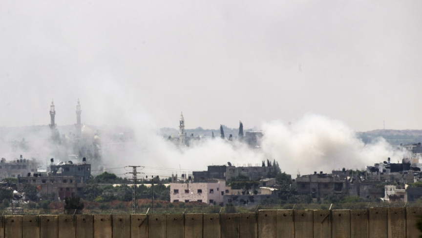 Smoke rises after an Israeli strike over the northern Gaza Strip Tuesday. Military and civilian casualties are mounting as Israeli forces push into urban areas like this.