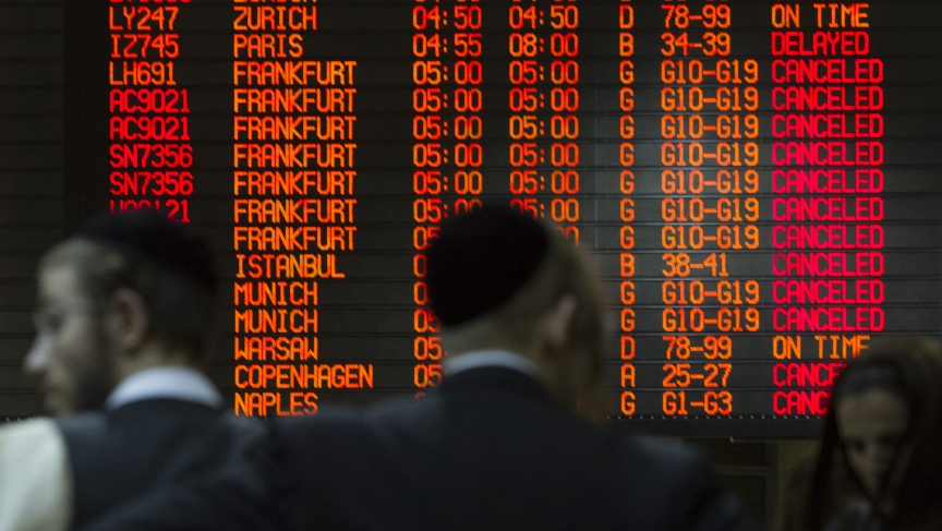 A departure board displays various cancellations at Ben Gurion International airport in Tel Aviv.