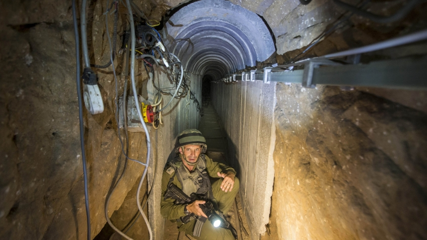An Israeli army officer during an army-organized tour in a tunnel said to be used by Palestinian militants for cross-border attacks.