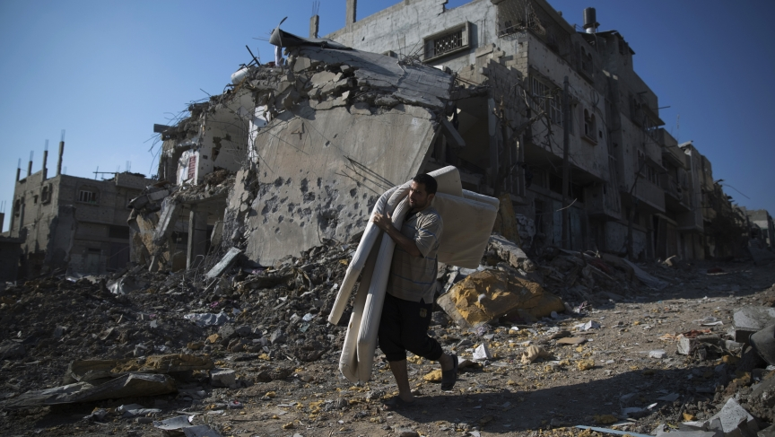 GazaA Palestinian man salvages belongings from damaged buildings in Gaza City's Shejaia neighborhood, which witnesses said was heavily hit by Israeli shelling and air strikes during an Israeli offensive.