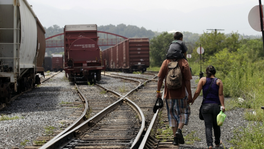 Migrant family crossing US-Mexico border on train