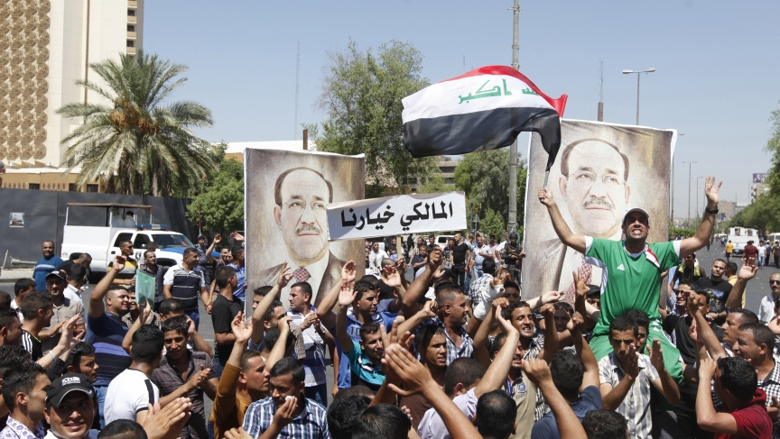 People with portraits of Iraqi Prime Minister Nouri al-Maliki rally in support of him in Baghdad on August 11, 2014.