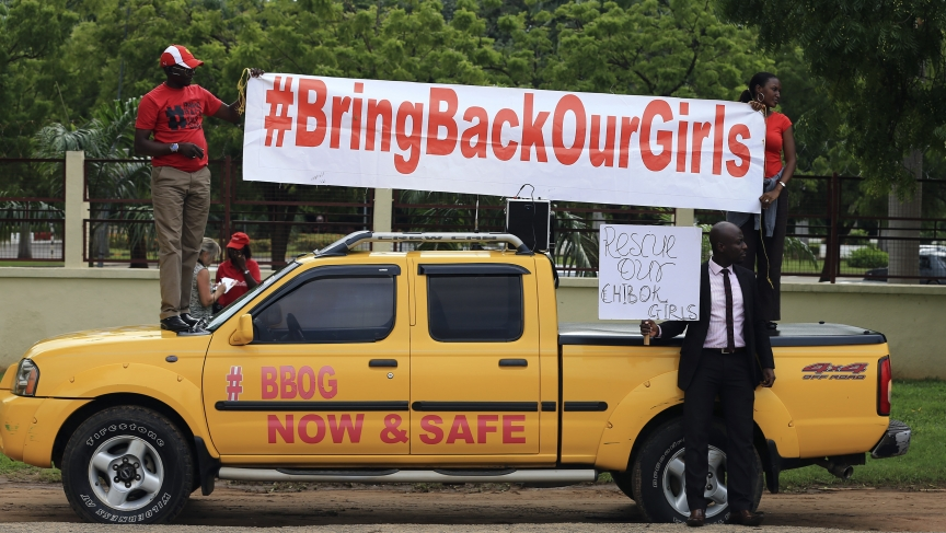 Demonstrators hold up a banner during a rally in Abuja that was held to mark the 120th day since the abduction of 200 schoolgirls by the Boko Haram Islamist groups on August 12, 2014.