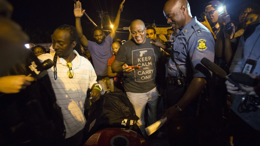 Highway Patrol Captain Ron Johnson talks to people during a peaceful demonstration, as communities react to the shooting of Michael Brown in Ferguson, Missouri, on August 14, 2014. Tensions in Ferguson eased after the Highway Patrol relieved St. Louis Cou