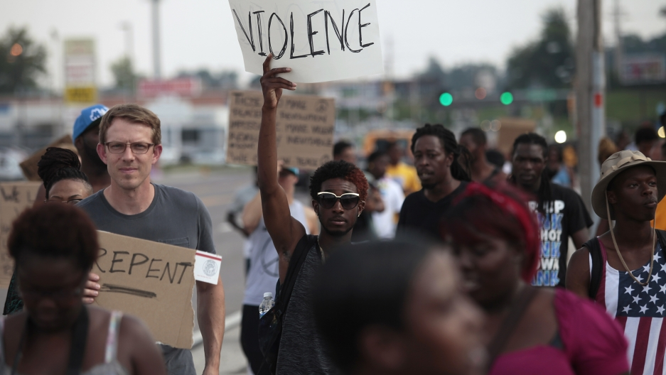 Demonstrators protest against the shooting death of Michael Brown in Ferguson, Mo., on August 18, 2014.