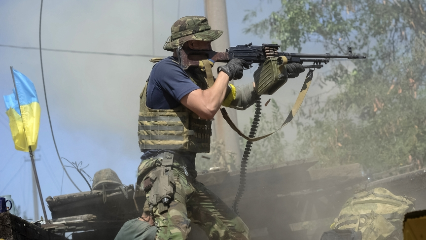 A Ukrainian serviceman fires at pro-Russian separatists in the eastern Ukrainian town of Ilovaysk, Tuesday.