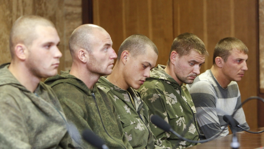 "A group of Russian servicemen detained by Ukrainian authorities attend a news conference in Kiev on August 27, 2014. Ukraine said on Tuesday its forces had captured a group of Russian paratroopers who had crossed into Ukrainian territory on a ""special mis"