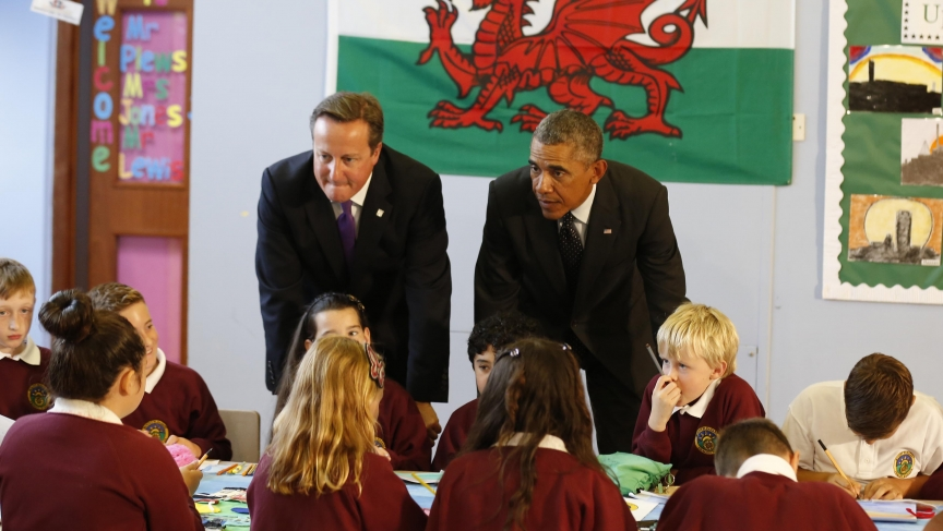 Barack Obama joins British Prime Minister David Cameron on a visit to a school prior to the NATO summit in Wales on Thursday. Western leaders are looking for strategies to deal with threats from Russia and the Islamic State.