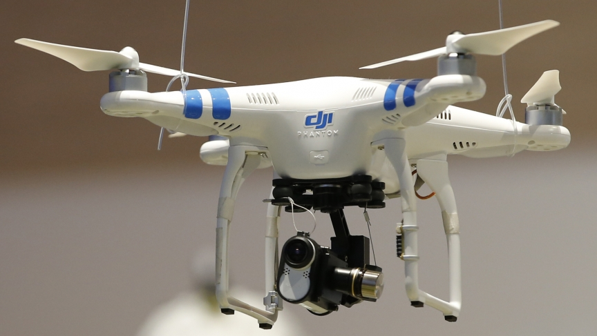A drone with Sony Action Cam Mini is pictured at the IFA consumer technology fair in Berlin, September 5, 2014.