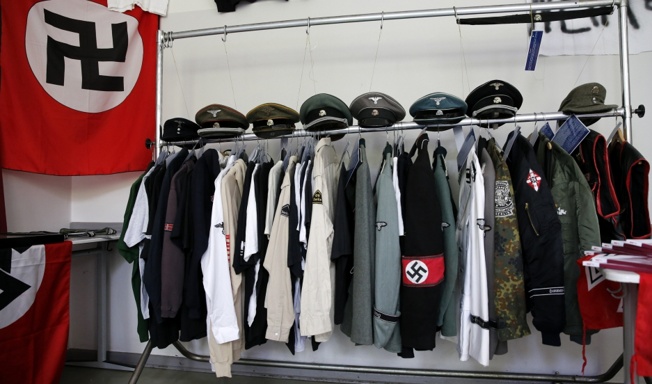 Nazi uniforms and a Swastika flag that were confiscated by the Berlin police during raids against German neo-Nazis are presented to the public during an open day at a police barracks in Berlin, September 7, 2014.