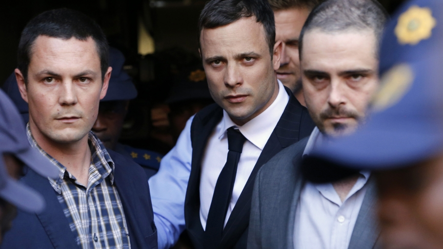 South African Olympic and Paralympic sprinter Oscar Pistorius leaves the North Gauteng High Court in Pretoria on September 11, 2014.