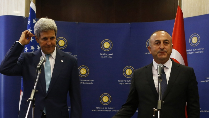 Secretary of State John Kerry and Turkey's Foreign Minister Mevlut Cavusoglu talk to the media before a meeting in Ankara. The United States is not getting all it wants from Turkey in the fight against the Islamic State.
