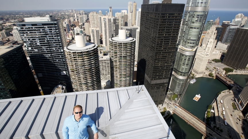 Daredevil Nik Wallenda poses for a photo on the rooftop of the Leo Burnett Building in Chicago on September 17, 2014.