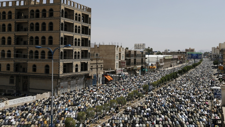 Followers of the Shi'ite Houthi movement perform Friday prayers on the airport road in Sanaa. Shiite rebels shelled Yemen's state-run television building in Sanaa on Friday and hundreds of residents fled in a dramatic escalation of violence.