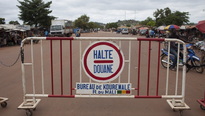 A sign is seen at the border with Guinea in Kouremale, October 2, 2014. The worst Ebola outbreak on record was first confirmed in Guinea in March but it has since spread across most of Liberia and Sierra Leone, killing more than 3,300 people, overwhelming