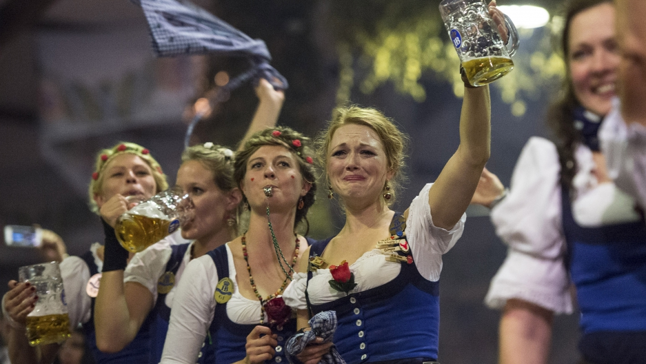 Oktoberfest waitresses celebrate the end of the world's biggest beer festival.