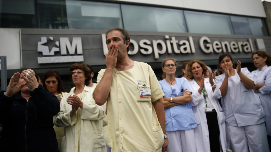 Health workers attend a protest on October 7, 2014, outside Madrid's La Paz Hospital calling for Spain's health minister, Ana Mato, to resign after a Spanish nurse contracted Ebola.