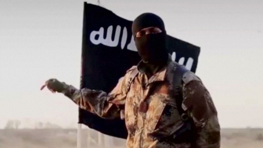 A masked man speaking in what is believed to be a North American accent in a video that Islamic State militants released in September 2014.