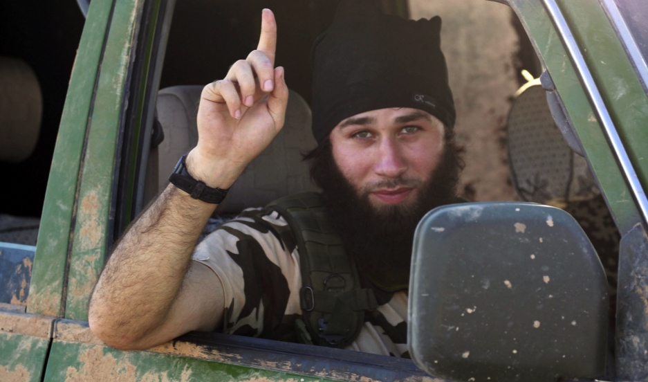 An Islamic State fighter gestures from a vehicle in the countryside of the Syrian Kurdish town of Kobani, after the Islamic State fighters took control of the area in October.
