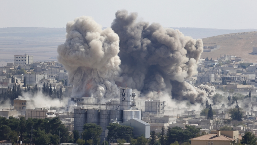 Smoke rises after a US-led air strike in the Syrian town of Kobane on October 8, 2014.