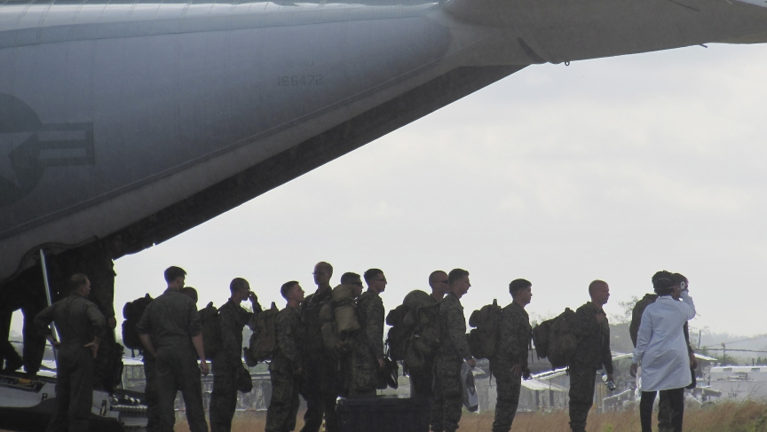 US Marines have their temperatures taken upon arrival at Roberts International airport outside Monrovia, Liberia, on October 9, 2014.