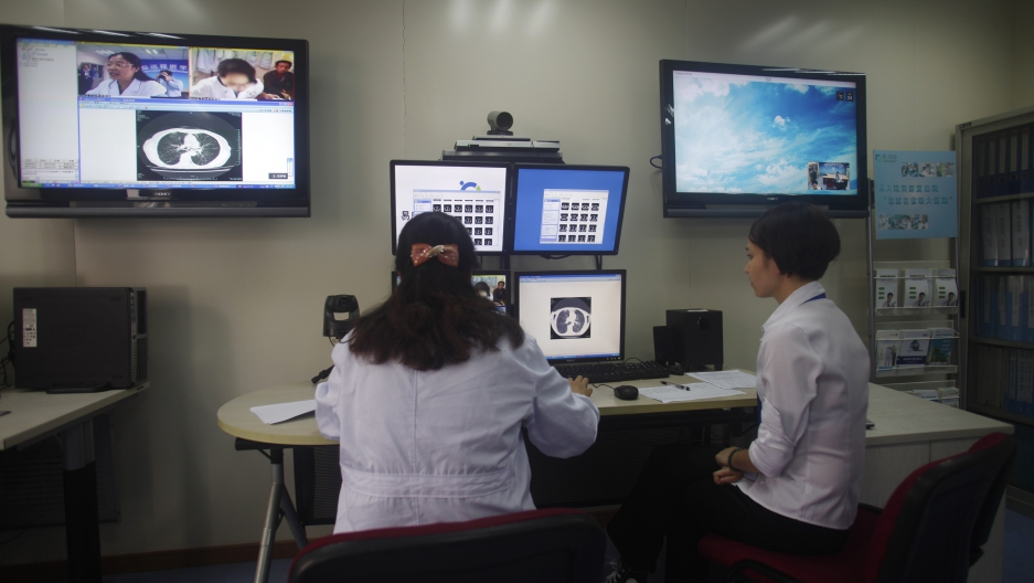 Doctors diagnose a patient remotely at the First Hospital of Zhejiang Province