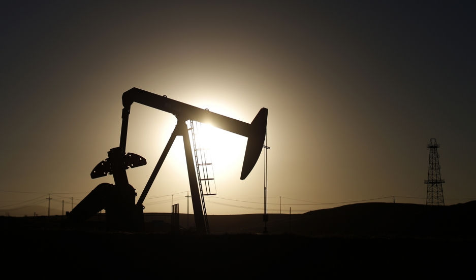 A pump jack is seen at sunrise near Bakersfield, California.