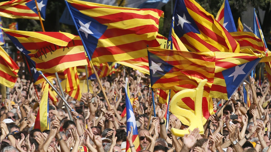 People wave Catalan separatist flags during a pro-independence demonstration at Catalunya square in Barcelona.