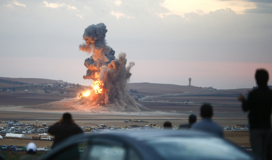 Smoke and flames rose over a hill after air strikes near the Syrian town of Kobani last year.