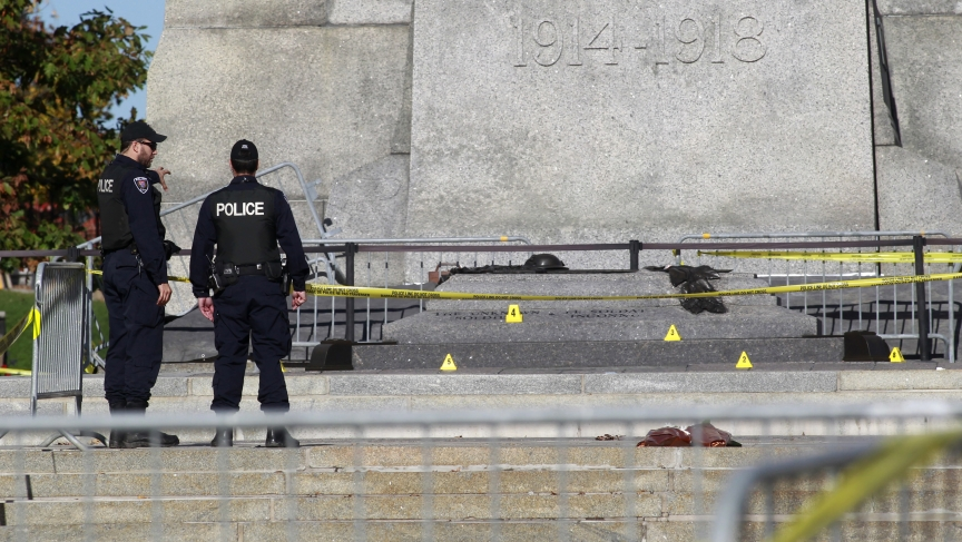 Police officers inspect the area around the National War Memorial in downtown Ottawa, where a Canadian soldier was shot and killed, on October 23, 2014.