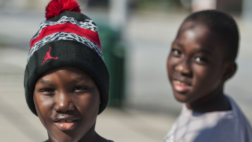"Young residents pose for a photograph on a street in the Clifton neighborhood of Staten Island in New York on October 25, 2014. The area is home to a community known as ""Little Liberia"" — it has the largest concentration of Liberians outside of Africa."