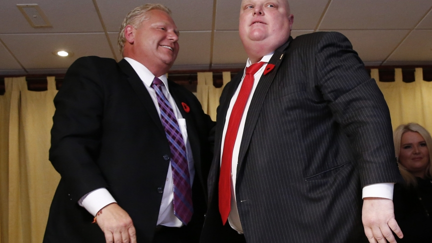Mayor Rob Ford (R) is congratulated by his brother Doug after it was announced that Rob was elected as a city councillor and that Doug was stopped in his bid to become mayor in the municipal election in Toronto, October 27, 2014.