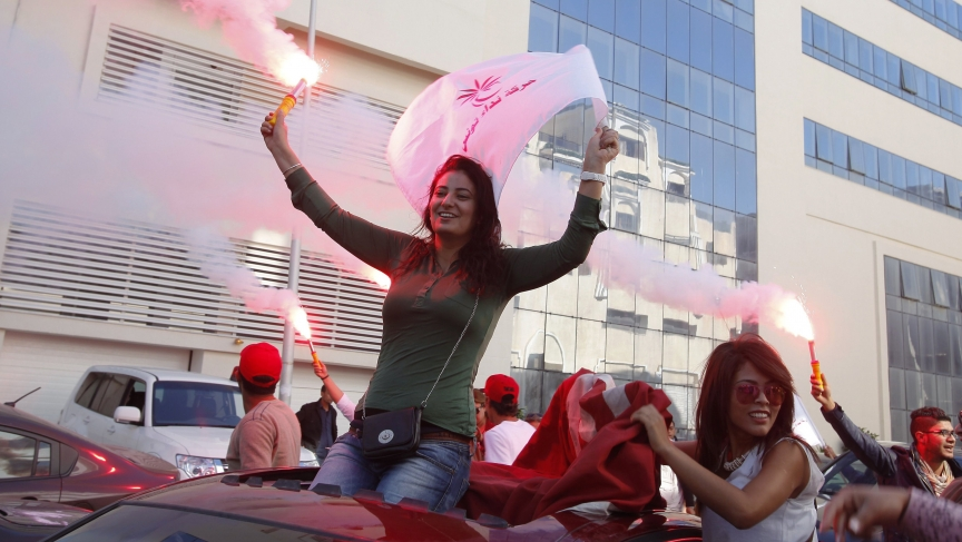 Supporters of the secular Nida Tounes (Call of Tunisia) party movement wave flags and shout slogans during parliamentary elections.