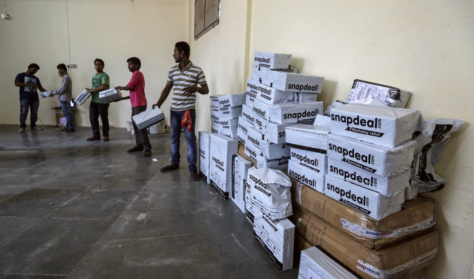 Employees of Snapdeal, an Indian online retailer, sort out delivery packages inside their company fulfillment center in Mumbai on October 22, 2014.