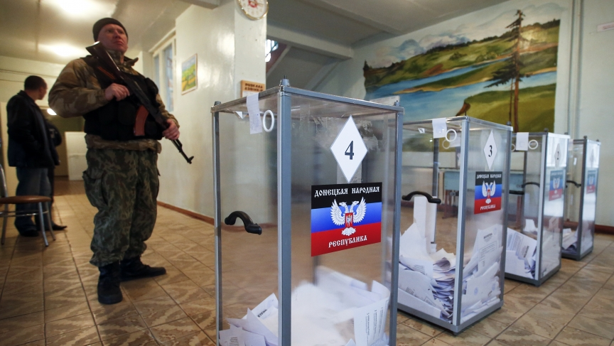 A pro-Russian separatist stands guard during the self-proclaimed Donetsk People's Republic leadership and local parliamentary elections on Sunday.