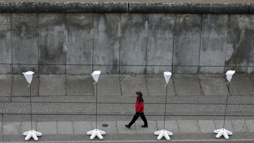 A part of the inner city of Berlin will be temporarily divided from November 7 to 9, 2014, with a light installation featuring 8,000 luminous white balloons to commemorate the 25th anniversary of the fall of the Berlin Wall. Here a woman walks in front of